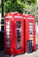 a pair of red british phone booths in london Unique Journal