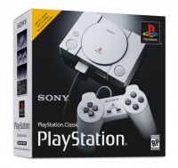 playstation classic console with 2 controllers