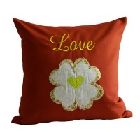red and yellow cushion cover cushion